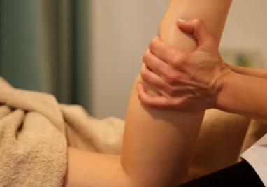 image showing Elena Long massage a calf
