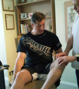 A Cage fighter being examined by Plymouth Chiropractor Kevin Kelly